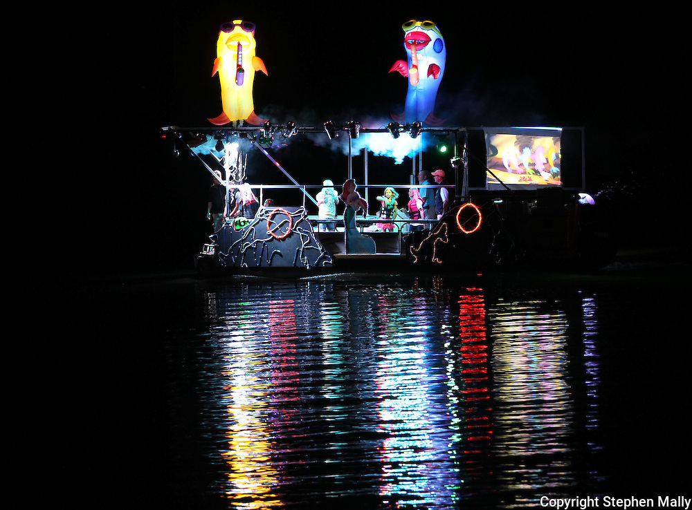 "A boat featuring music and decorations from ""The Little Mermaid"" participates in the Cedar Boat Club Venetian Nights Lighted Boat Parade and Fireworks along the Cedar River on Saturday evening, August 18, 2012."