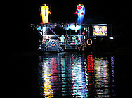 """A boat featuring music and decorations from """"The Little Mermaid"""" participates in the Cedar Boat Club Venetian Nights Lighted Boat Parade and Fireworks along the Cedar River on Saturday evening, August 18, 2012."""