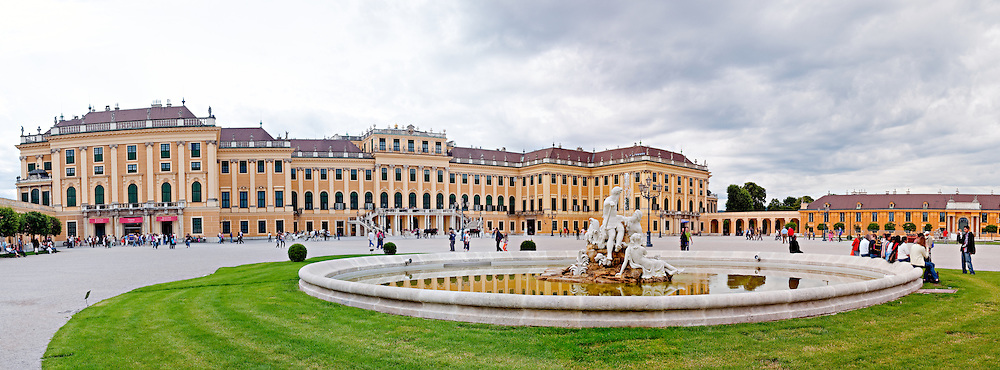 Fountain in the main entrance courtyard of the front of Schonbrunn Palace, Vienna, Austria