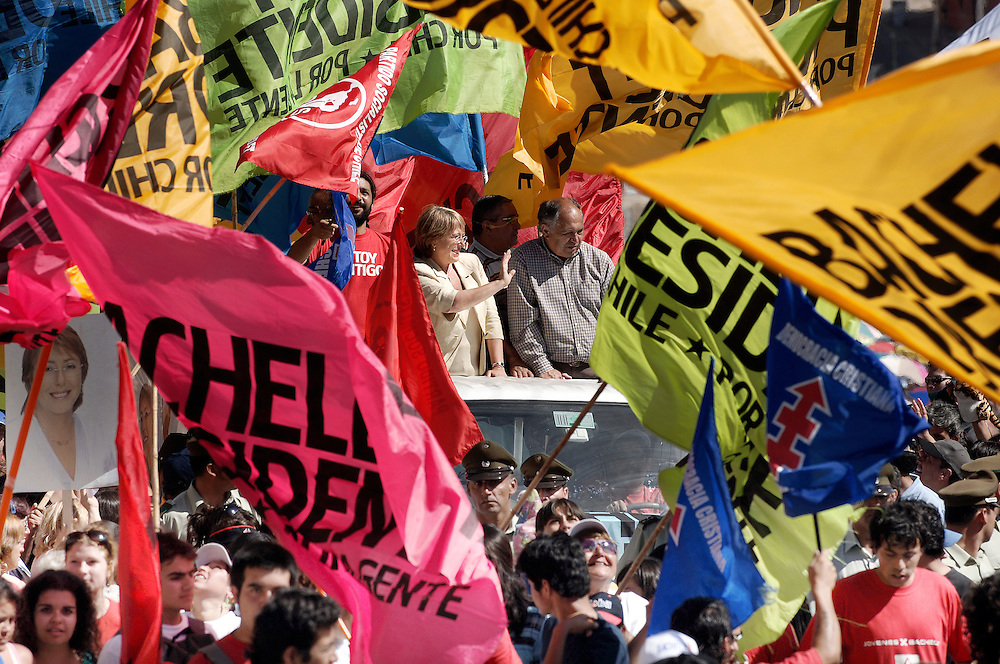 USE ARROWS ← → on your keyboard to navigate this slide-show<br /> <br /> Cartagena, Chile 07 Jaunary 2006<br /> Chile's presidential candidate Michelle Bachelet of the Socialist Party is greeted during a campaign rally. Michelle Bachelet was widely favoured in a poll on Saturday to become Chile's first woman president in an election next week, although a large bloc of undecided voters could still swing the vote.<br /> Photo: Ezequiel Scagnetti