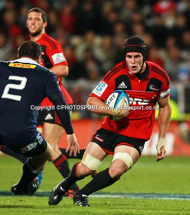 Crusaders player Matt Todd facing tackler for the Stormers Christiaan Liebenberg. Super Rugby game between the Crusaders and the Stormers. Crusaders new Christchurch Stadium at Rugby League Park, Saturday 14 April 2012. Photo : Joseph Johnson / photosport.co.nz