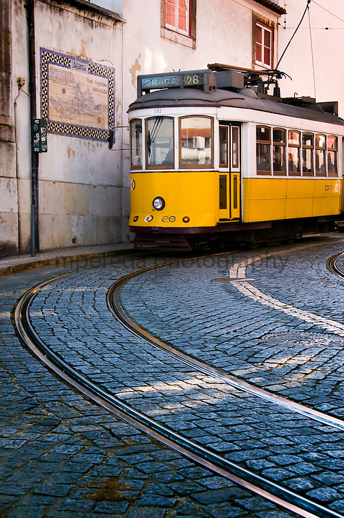 Tram in the streets of the Alfama district of Lisbon