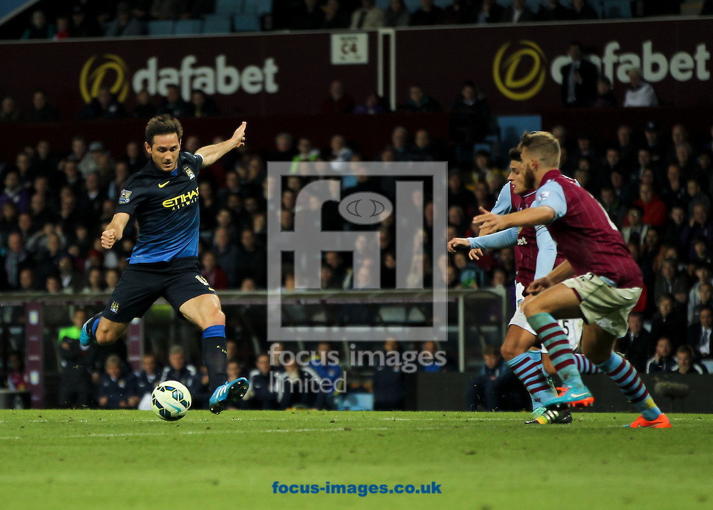 Frank Lampard (left) of Manchester City shapes up to shoot during the Barclays Premier League match at Villa Park, Birmingham<br /> Picture by Tom Smith/Focus Images Ltd 07545141164<br /> 04/10/2014