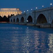 The Lincoln Memorial and Arlington Memorial Bridge are seen at dusk on the Potomac River. The Lincoln Memorial honors the 16th President of the United States. Located on the National Mall in Washington, DC, the monument contains a large seated sculpture of Abraham Lincoln and inscriptions of two well-known speeches by Lincoln, The Gettysburg Address and his Second Inaugural Address.