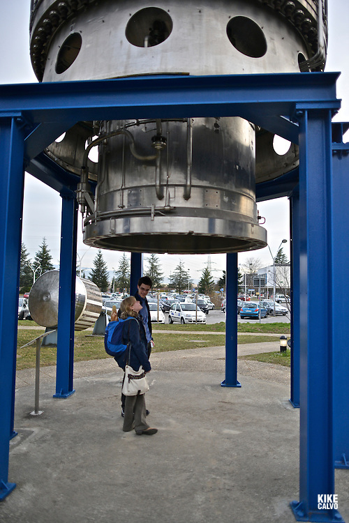 Couple looking at a 26-ton Big European Bubble Chamber (BEBC), filled with 30 cubic metres of liquefied gas, recorded the interactions of elementary particles. CERN, the European Organization for Nuclear Research, is the biggest particle physics laboratory in the world.