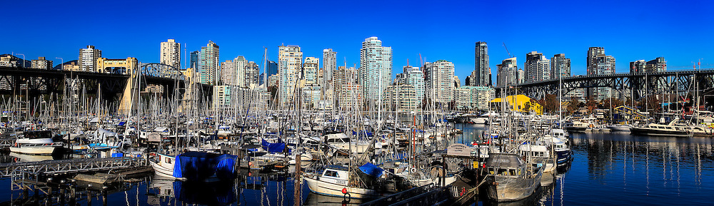 Vancouver - False Creek: A panoramic view of False Creek and downtown Vancouver under a brilliant blue autumn sky, British Columbia Canada.