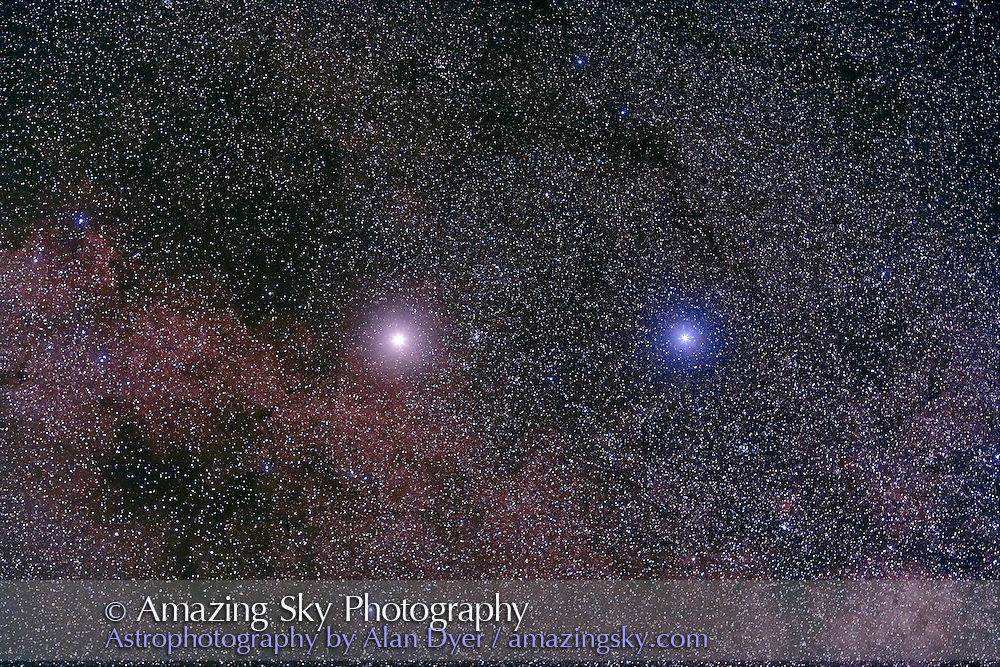 Alpha and Beta Centauri. Taken with Canon 135mm L-series lens at f/4 and Hutech-modified Canon 5D camera at ISO 400 for stack of 6 x 4 minute exposures, two in haze to fuzz stars. Taken from South Pacific Star Party, Ilford, NSW, Australia, April 15, 2007.