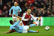 Danilo (3) of Manchester City tackles Jack Wilshere (10) of Arsenal during the EFL Cup Final match between Arsenal and Manchester City at Wembley Stadium, London, England on 25 February 2018. Picture by Graham Hunt.