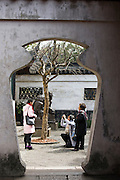 Visitors take photographs in the Yu Gardens, Shanghai, China