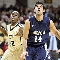 Arsalan Kazemi (14) of Iran, and Central Florida guard/forward Isaiah Sykes (32) look for a rebound during a Conference USA NCAA basketball game between the Rice Owls and the Central Florida Knights at the UCF Arena on January 22, 2011 in Orlando, Florida. Rice won the game 57-50 and extended the Knights losing streak to 4 games.  (AP Photo/Alex Menendez)