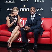 NFL Player Adrian Peterson being interviewed by NFL networks Alex Flanagan at the Mahalia Jackson Theatre NFL Honors in New Orleans, Louisiana on Feb.2 2013.