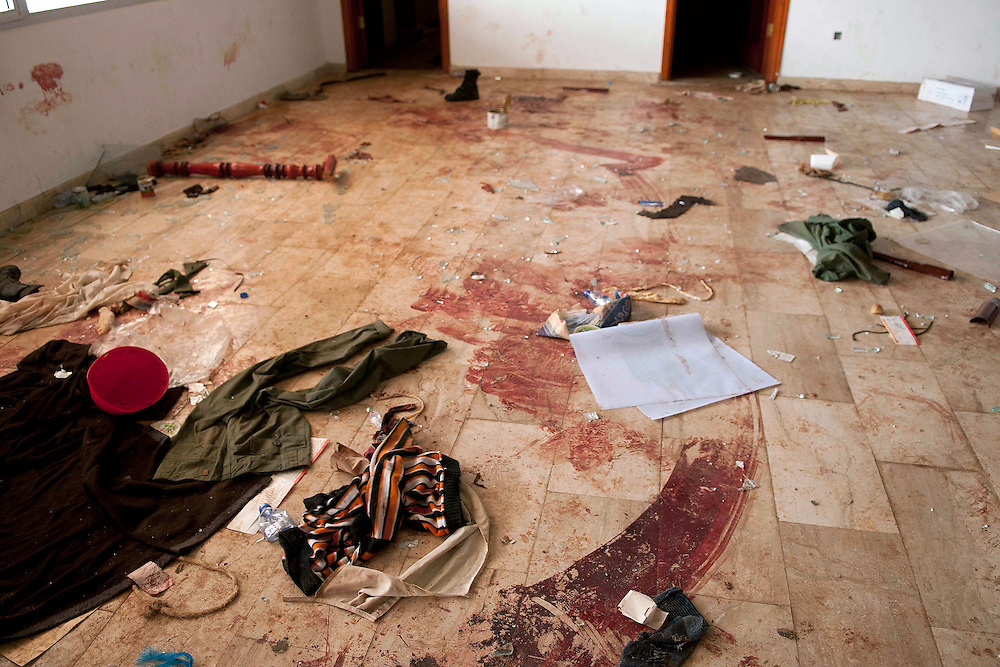 Blood and clothes on the floor at the Labraq Airport terminal near Shahat, where 22 mecenaries loyal to Gadaffi were killed by the opposition. 600 mercenaries fought the oppostion in a firefight lasting three days.