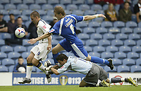 Photo: Aidan Ellis.<br /> Leeds United v Cardiff City. Coca Cola Championship. 19/08/2006.<br /> Cardiff keeper Neil Alexander and Gary Loovens combine to stop Leeds David Healy