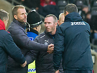 Football - 2017 / 2018 Premier League - Swansea City vs. Leicester City<br /> <br /> Leicester City caretaker manager Michael Appleton & his assistants shake hands with their Swanea counterparts after the match  , at the Liberty Stadium.<br /> <br /> COLORSPORT/WINSTON BYNORTH