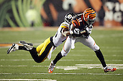 Cincinnati Bengals wide receiver Mohamed Sanu (12) catches a third quarter pass good for a first down as he gets tackled by diving Pittsburgh Steelers defensive back Brandon Boykin (25) during the NFL AFC Wild Card playoff football game against the Pittsburgh Steelers on Saturday, Jan. 9, 2016 in Cincinnati. The Steelers won the game 18-16. (©Paul Anthony Spinelli)