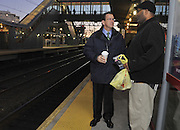 Democratic candidate for governor Dan Malloy greets people waiting for the train at sunrise on Election Day. (AP Photo/Jessica Hill)