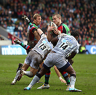 London - Saturday April 3rd, 2010: Mike Brown of Harlequins is tackled by Gcobani Bobo (14) of Newcastle during the Guinness Premiership match between Harlequins and Newcastle at the Twickenham Stoop, London. (Pic by Andrew Tobin/Focus Images)