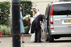 The bride arriving aand her father at the wedding of Nicholas Van Cutsem to Alice Hadden-Paton at The Guards Chapel, Wellington Barracks, London on 14th August 2009.