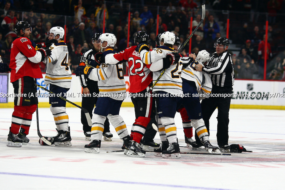 29 December 2014: A scrum breaks out in the final seconds of the third period during a game between the Sabres and Senators at Canadian Tire Centre in Ottawa, On. ***** Editorial Use Only *****