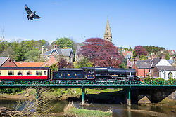 © Licensed to London News Pictures. 26/04/2019. Ruswarp UK. 1937 Locomotive LMS 5428 crosses the river Esk in the picturesque village of Ruswarp as it travels along the North Yorkshire Moors Railway towards Whitby today. Photo credit: Andrew McCaren/LNP