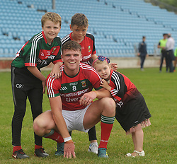 Mayo U20 Jordan Flynn from Crossmolina after the win against Leitrim with supporters Ronan Sweeney, Dylan and Darcy Flynn.<br />Pic Conor McKeown