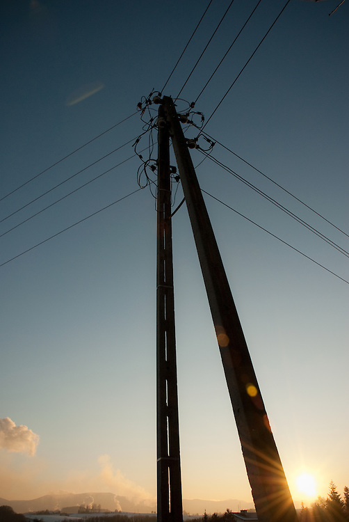 A winter sunset and electricity pylon in the Beskidy mountains of southern Poland. January 2009.