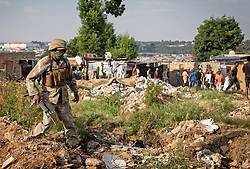JOHANNESBURG, April 21, 2020  A soldier of South African National Defense Force patrols in Johannesburg, South Africa, April 20, 2020..  South Africa's COVID-19 cases have surged to 3,300, up by 142 from the previous count, Health Minister Zweli Mkhize said Monday. (Photo by Yeshiel/Xinhua) (Credit Image: © Xinhua via ZUMA Wire)