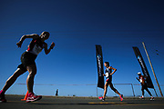 GEORGE, SOUTH AFRICA - OCTOBER 21: Elmarie Bezuidenhout of Eastern Province (152) walks in the opposite direction of Zelda Schultz of Athletics Gauteng North (AGN) in the women's 20km during the ASA Race Walking Championship at Pacaltsdorp on October 21, 2017 in Goerge, South Africa. (Photo by Roger Sedres/Gallo Images)