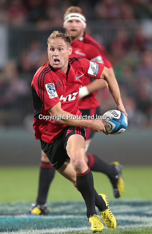 Andy Ellis of the Crusaders makes a break during the Super Rugby match between the Crusaders and the Bulls at AMI Stadium on Saturday March 15, 2013 in Christchurch, New Zealand. Photo: Martin Hunter/Photosport