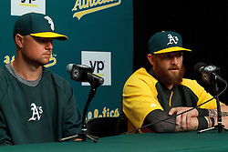 OAKLAND, CA - AUGUST 01:  Jonny Gomes #15 of the Oakland Athletics speaks next to Jon Lester #31 during a press conference before the game against the Kansas City Royals at O.co Coliseum on August 1, 2014 in Oakland, California. (Photo by Jason O. Watson/Getty Images) *** Local Caption *** Jonny Gomes; Jon Lester