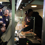 Fast food is prepared during the New York Yankees V Detroit Tigers Baseball game at Yankee Stadium, The Bronx, New York. 28th April 2012. Photo Tim Clayton