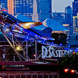 Roasterie Coffee Company's Douglas DC-3 airplane in front of the downtown Kansas City MO skyline at dusk, summer 2013.