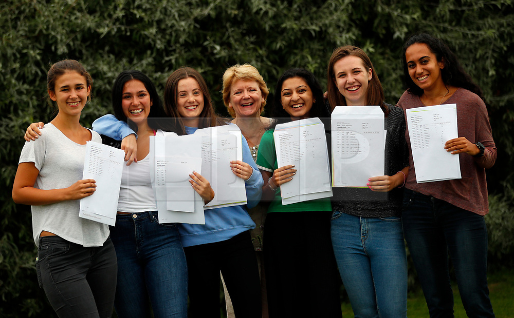 © Licensed to London News Pictures. 17/08/2017. LONDON, UK. <br /> LADY ELEANOR HOLLES STUDENTS RECEIVE TOP A LEVEL RESULTS <br /> Head teacher Heather Hambury and students from Lady Eleanor Holles school in Hampton, south-west London pose for a photograph after receiving their Alevel results today. Lady Eleanor Holles School achieved 96% of students passing with grades A*-B.<br /> Photo credit: LNP