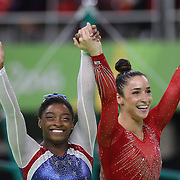 Gymnastics - Olympics: Day 6 Simone Biles #391 of the United States and Alexandra Raisman #395 of the United States embrace as the final result comes through confirming gold and silver medal for the pair during the Artistic Gymnastics Women's Individual All-Around Final at the Rio Olympic Arena on August 11, 2016 in Rio de Janeiro, Brazil. (Photo by Tim Clayton/Corbis via Getty Images)