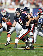 CHICAGO - OCTOBER 8:  Quarterback Rex Grossman #8 of the Chicago Bears hands the ball off on a running play against the Buffalo Bills at Soldier Field on October 8, 2006 in Chicago, Illinois. The Bears defeated the Bills 40-7. ©Paul Anthony Spinelli *** Local Caption *** Rex Grossman