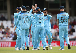 England's players celebrate taking the wicket of Afghanistan's Dawlat Zadran during the ICC Cricket World Cup Warm up match at The Oval, London.