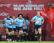 Phil Waugh leads the Waratahs onto Suncorp Stadium during action from the Super 15 Rugby Union match played between the Queensland Reds and the NSW Waratahs at Suncorp Stadium (Brisbane, Australia) on Saturday 23rd April 2011<br /> <br /> Conditions of Use : NO AGENTS ~ This image is intended for Editorial use only (news or commentary, print or electronic) - Required Images Credit &quot;Steven Hight - Aura Images&quot;