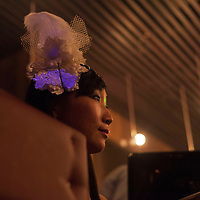 BEIJING, NOVEMBER -24 : an entertainer in  an underground lesbian club in Beijing waits for her turn.