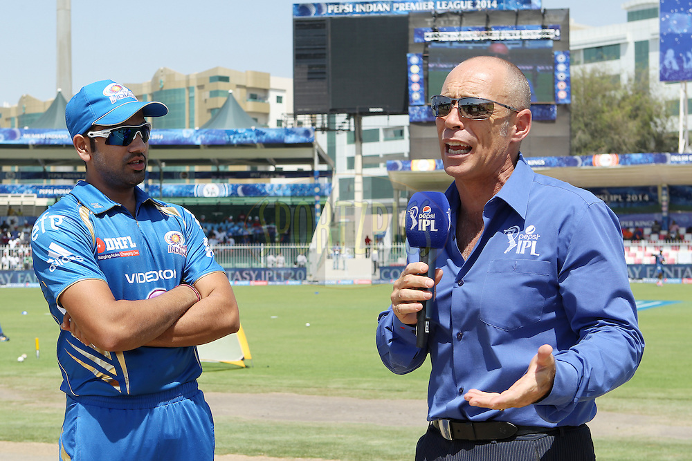 Rohit Sharma captain of of the Mumbai Indians interviewed before the toss during match 16 of the Pepsi Indian Premier League 2014 between the Delhi Daredevils and the Mumbai Indians held at the Sharjah Cricket Stadium, Sharjah, United Arab Emirates on the 27th April 2014<br /> <br /> Photo by Ron Gaunt / IPL / SPORTZPICS