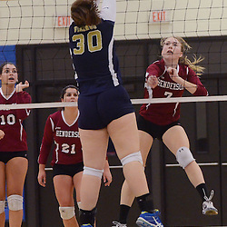 Photos by Tom Kelly IV<br /> Henderson's Courtney Deacon (7) spikes the ball past Upper Merion's Eryn Brady (30) during the District One semifinal volleyball game between West Chester Henderson and Upper Merion at Norristown High School, Thursday night October 31, 2013.
