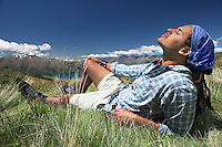 Man lying in field feeling sun