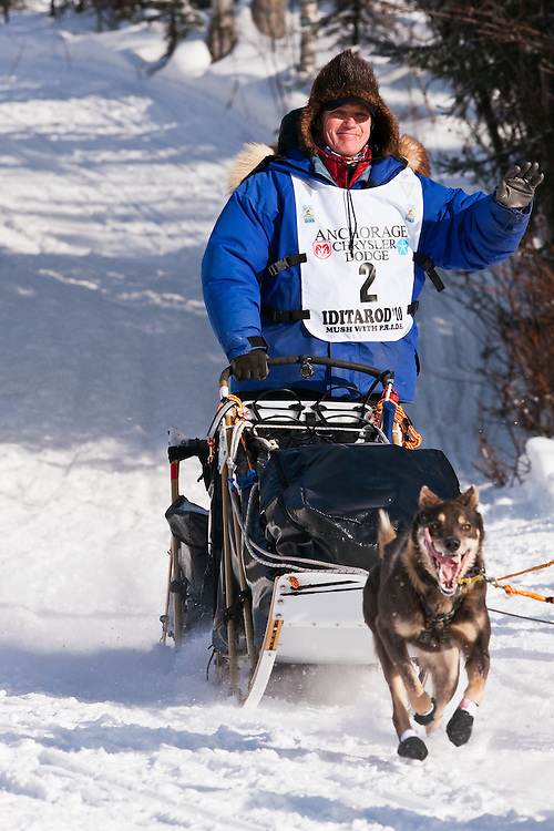 Musher Linwood Fiedler competing in the 38th Iditarod Trail Sled Dog Race entering Long Lake after leaving the Willow Lake area at the restart in Southcentral Alaska.  Afternoon.