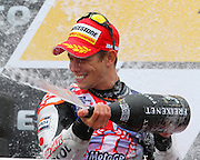 World Moto GP Championship.<br /> Round16.Phillip Island.Australia.Sunday16.10.2011.<br /> #27 Casey STONER (AUS) Repsol Honda Team.<br /> Wins the race and is crowned the 2011 Moto GP Champion on his 26th birthday.<br /> Here fitted with the World Champion Top , celebrating on the podium.<br /> © ATP Photo/ Damir IVKA<br /> Motorrad-WM - MotoGP in Australien - Motorrad - Moto GP -Motorradsport - Grand Prix in Phillip Island - Motorcycle racing in Australia - Moto2 - 16.10.2011 - <br /> - fee liable image - Photo Credit: © ATP / Damir IVKA