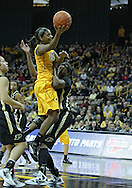 January 28, 2012: Iowa Hawkeyes guard Theairra Taylor (23) puts up a shot around Purdue Boilermakers forward Alex Guyton (41) during the NCAA women's basketball game between the Purdue Boilermakers and the Iowa Hawkeyes at Carver-Hawkeye Arena in Iowa City, Iowa on Saturday, January 28, 2012.