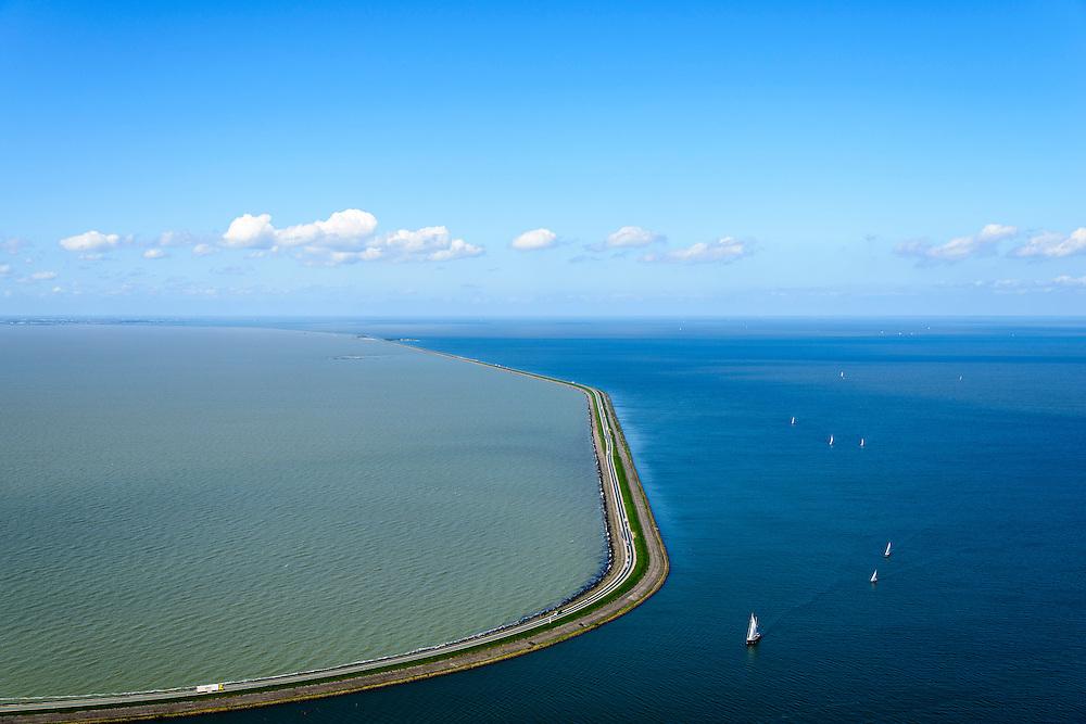 Nederland, Flevoland, Lelystad, 07-05-2015. Houtribdijk verbindt Enkhuizen en Lelystad en deelt het IJsselmeer in IJsselmeer en Markermeer (links). De foto is gemaakt richting Enkhuizen, Trintelhaven en proefmoeras Marker Wadden halverwege. De Houtribdijk is oorspronkelijk aangelegd om het Markeermeer in te polderen tot Markerwaard. De plannen voor deze inpoldering maakte reeds deel uit van de Zuiderzeewerken. Andere namen voor de dijk zijn: Markerwaarddijk, Lelydijk, Dijk Enkhuizen-Lelystad, N302.<br /> Houtrib dike linking Enkhuizen and Lelystad, dividing lake IJsselmeer in IJsselmeer and Marker lake(left). The photo was taken towards Enkhuizen. The dike was originally built make the reclamation of the polder Markerwaard possible. The plans for the reclamation was already part of the Zuiderzee Works (1891).<br /> luchtfoto (toeslag op standard tarieven);<br /> aerial photo (additional fee required);<br /> copyright foto/photo Siebe Swart