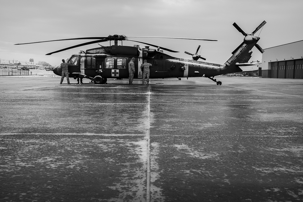 Ice covers the concrete Pad from the snow fall as a MEDEVAC crew prepares for the day.