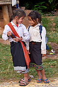 Laos, Xieng Khouang Province. Hill tribe people at Ban Nam Chat. Schoolgirls.