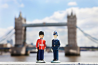 Figurines of police officer and coldstream guard with London Bridge in background