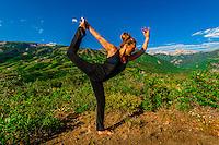 Woman doing yoga, Rim Creek Trail, above Snowmass Village (Aspen), Colorado USA.