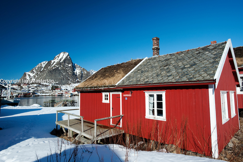 Traditional red wooden Rorbu fisherman`s hut in village of Reine in Lofoten Islands in Norway